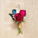 Ruby red rose boutonniere.