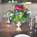 Rustic centerpiece with ruby red peonies and blueberries.