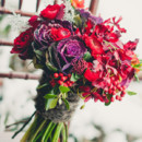 Red ranunculus, purple cabbage and berry bouquet.