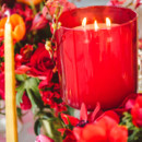 Ruby red candle and floral centerpieces.