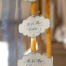 Golden yellow ribbon escort card display.