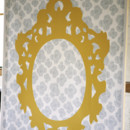 Grey patterned photo backdrop painted with golden yellow frame.