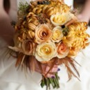 Bridal bouquet filled with golden yellow football mums and roses.