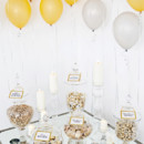 Sleek snack station with apothecary jars and balloons.