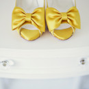 Golden yellow bridal shoes with lovely bow details.
