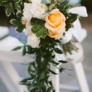 Lovely golden yellow rose and greenery aisle marker.