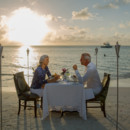 130x130 sq 1414458428126 carolyns grande antigua older couple dining by bea