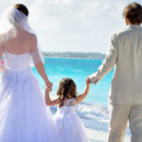 130x130 sq 1414458838658 carolyns bridal couple with daughter on beach beac