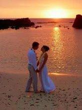 220x220 1317164140032 weddingbeachcouple