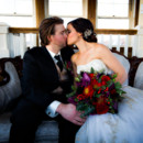 130x130 sq 1458231820827 bride and groom kiss on couch