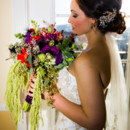 130x130 sq 1458232255515 bride with flowers next to window