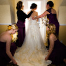 130x130 sq 1458232383808 bridesmaids helping bride with dress
