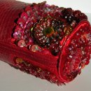 130x130 sq 1204899338437 mbag strap red closeup