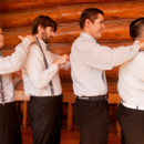130x130 sq 1447100776327 groom and groomsmen making sure everyone looks goo