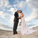130x130 sq 1492810768634 bride with white flowers in hair at beach