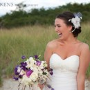 130x130 sq 1492810774903 bride smiling on the beach with purple and white f