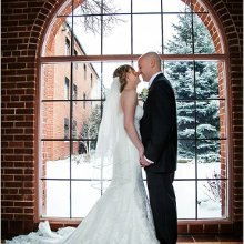 220x220 sq 1360858214555 brideandgroomposeinwindow