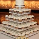 130x130 sq 1418398484919 butter cream swirled cupcakes on white tower