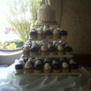 130x130 sq 1418398663609 100 cupcakes on white tower