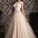 Style No. 9022  <br /> Romantic and classic. This ball gown combines lace and English Net perfectly. The lace bodice features a scoop neckline with cap sleeves while Swarovski crystals accent the waistline. The back has a lovely keyhole detail while a soft gathered skirt finishes the style.