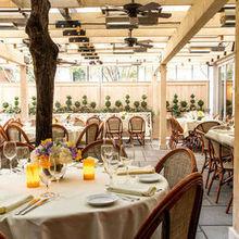 220x220 sq 1516125469 95e6e262d97bd1bf patio formal set up from main dining room