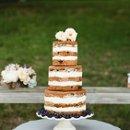Hair Stylist: Neon Hair Design  Floral Design: Victorian Gardens  Wedding Gown: Modern Trousseau  Cake Design: Classic Cakes  Equipment Rentals: Hickory Dickory Store  Makeup: Jolie Artistry