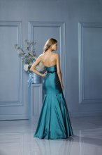 476 Back Color Shown: Teal/Black Strapless neckline Fit and flare silhouette Single-faced satin, skinny bow ribbon belt at waist