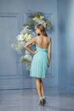 436 Color Shown: Ocean Sweetheart neckline Double spaghetti strap Gathered waistband Draped overlay on gathered skirt Above-the-knee length skirt