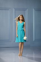 486 Color Shown: Aqua V-neck, v-back Criss-cross draped bodice Self tie at waist Soft pleated, above-the-knee length, full skirt