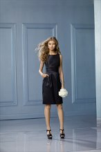 474 Color Shown: Black Bateau neckline Gathered waistband Pockets Slim, above-the-knee length skirt
