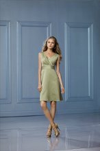 468 Color Shown: Kiwi/Kiwi Draped, v-neck with modified cap sleeve Above-the-knee length, a-line skirt