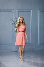 492 Color Shown: Coral/Tomato Spaghetti strap, ruffled, sweetheart neckline. Single-faced satin ribbon at waist. Above-the-knee, bias cut, a-line skirt
