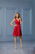 478 Color Shown: Cherry V-neck, v-back Gathered waistband Pockets Full, pleated, above-the-knee length skirt