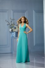 495 Color Shown: Mermaid V-neck, halter neckline Ruffle back detail Ruched band at empire Floor-length, a-line skirt