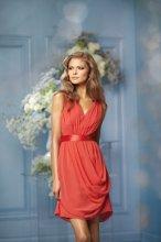 483 Color Shown: Mandarin/Tomato V-neck Single-faced satin ribbon at waist High illusion back with slit center opening Side over drape skirt Above-the-knee length skirt
