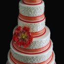 130x130_sq_1357853039343-orangewhitescrollcake