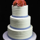130x130 sq 1433365154565 trio of roses with thin band wedding cake
