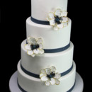 130x130 sq 1449522046305 gold edged anemone wedding cake