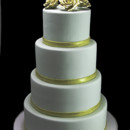 130x130 sq 1449524263368 gold metallic roses  thin band wedding cake