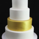 130x130 sq 1449524401065 wedding cake with gold tier