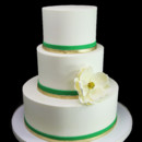 130x130 sq 1459533830504 gold  green double band with magnolia wedding cake