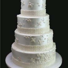 220x220 sq 1420744379632 fanciful flowers wedding cake