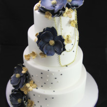 220x220 sq 1420744824651 gold tipped blue magnolias wedding cake