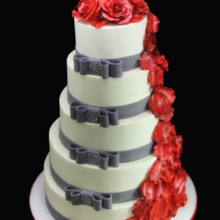 220x220 sq 1420745400694 rose petal cascade  double side bow wedding cake