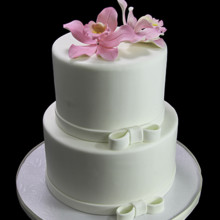220x220 sq 1449520479194 side bow with orchids wedding cake