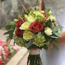 130x130 sq 1319755674144 yellowredweddingbouquet