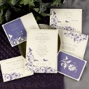 "English Garden: An ecru invitation card features a whimsical bird design in the color selection of your choice. 5 1/4"" x 7 1/4"", Collection includes: Invitation, Save the Date, Menu Card, Informal Notes, Reception Card, Response Card, Envelope Icing (Available in Multiple Colors)"