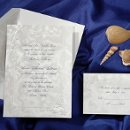 On European paper, this beautiful invitation has an embossed border decorated with gems of the ocean. (T8912)
