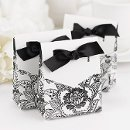"Floral Favor Boxes-White - White favor boxes with black floral pattern and white flaps. Black 5/8"" pre-cut, satin ribbon included. 3"" x 3 3/4"" x 1 3/8"". Available in multiple colors and styles."