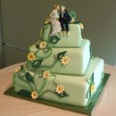 130x130 sq 1318392854315 brideandgroomontopofgreen